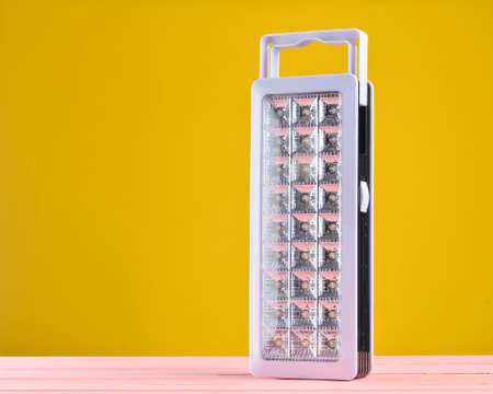 Plastic led flashlights on yellow background