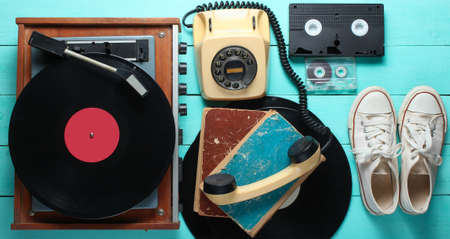 Obsolete objects on the Blue wooden background. Retro style, 80s, pop media