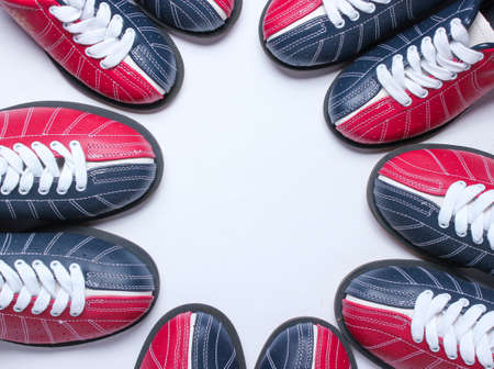 Many bowling shoes on a white background. Entertainment for groups of friends. Copy space. Top view