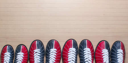 Many bowling shoes on floor. Entertainment for groups of friends. Copy space. Top view