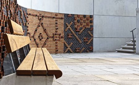 clinker: empty seat in front of a stone and concrete wall in Hamburg s HafenCity, Hamburg, Germany