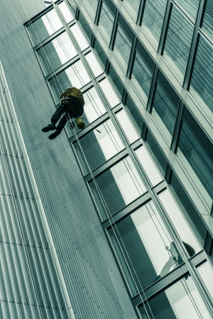 abseiling: Window cleaner abseils from a skyscraper