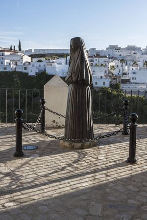 veiled: Statue in the small Andalusian town of Vejer Stock Photo