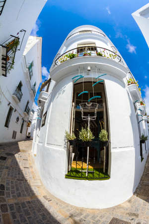 corner house: photographed with fisheye corner house in the Andalusian town of Vejer, Spain Stock Photo