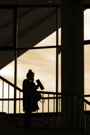 secretly: woman in the Shadows Stock Photo