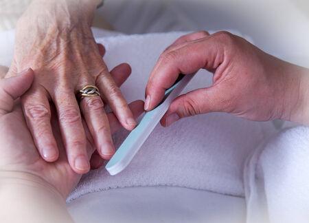 the elderly caregivers: Seniorenhnde in nail care Stock Photo
