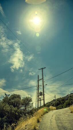 megawatt: electricity pylon against the light