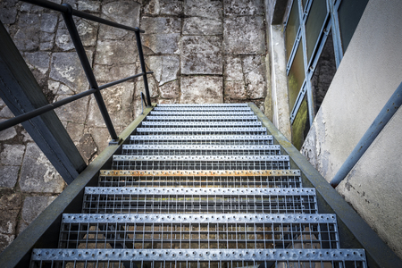 grate: Iron staircase down Archivio Fotografico