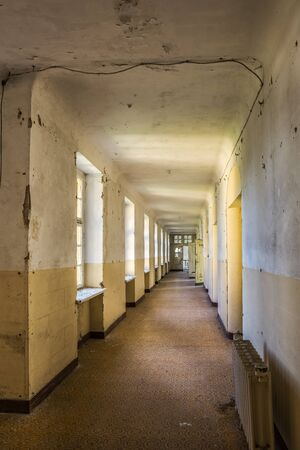 imposition: long corridor in an abandoned villa