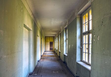 stay on course: long corridor in an abandoned villa