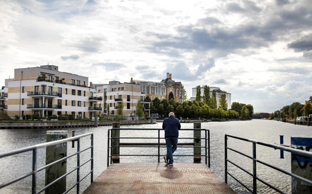 a man stands at the waterfront in Berlin Tegel
