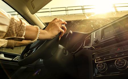 bangles hand: Woman at the wheel of a moving car