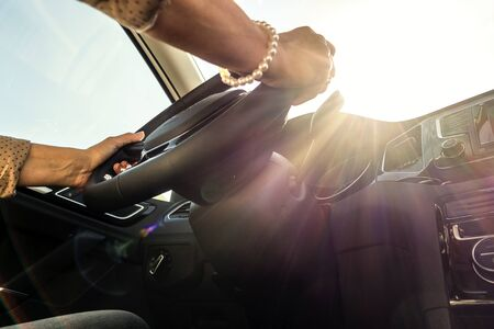 blinded: Woman at the wheel of a moving car