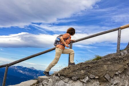 ascend: a hiker on mountain