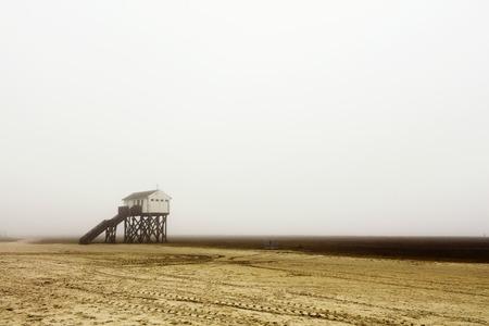 stilt house: Fog on the beach