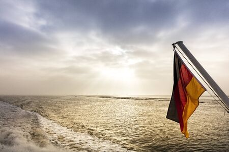 wistfulness: the German flag on the sea Stock Photo