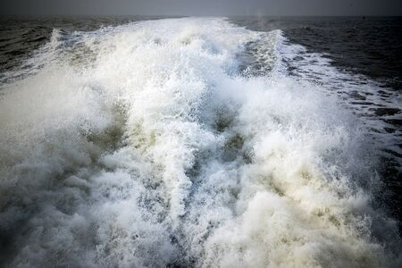 tidal wave: Wave at the stern of a boat Stock Photo