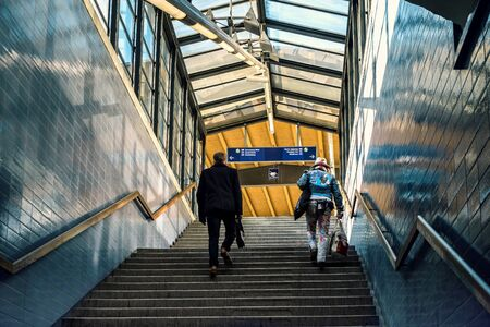 to go up: two men go up the stairs to the station
