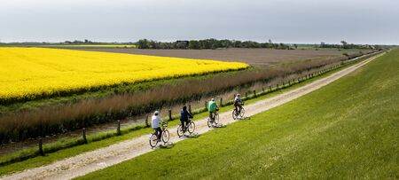 feld: Cyclist during cycling holiday in the north of Germany Editorial