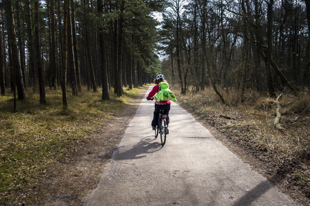 a cyclist in the forest Stock Photo