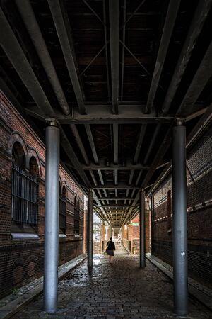 dark path in the Speicherstadt in Hamburg Stock Photo