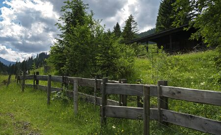 Wooden fence on a mountain pasture in Bavaria