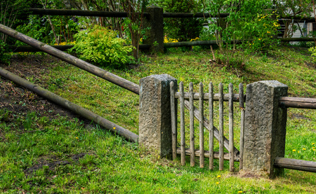 fence with wooden gate Stock Photo