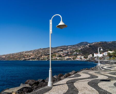 Lantern on a promenade by the sea