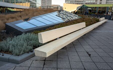 Long wooden bench on the roof of bikini house in berlin