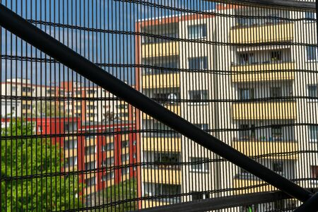 Looking through a grid on residential buildings in Berlin