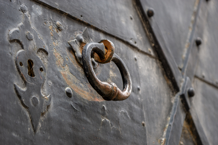 Handle on an old door in a fortress Redakční