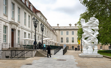 The sculpture Runner by Tony Cragg in front of the entrance to the Palais Populaire on Bebelplatz Unter den Linden in Berlin