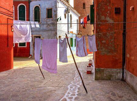 Clothesline in the backyard on the island of Burano near Venice 写真素材