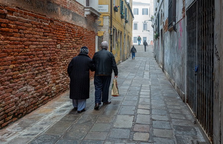 Senior couple in an alley in Venice