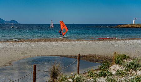 Surfer on the beach of Sardinia