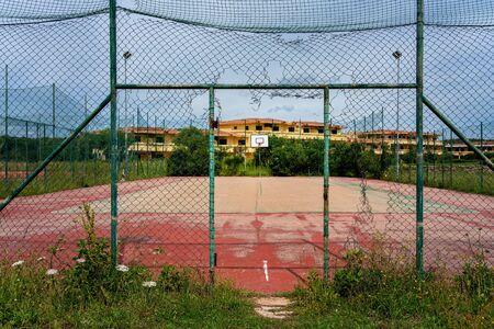 Maroder sports field with marodic fence on the island of Sardinia