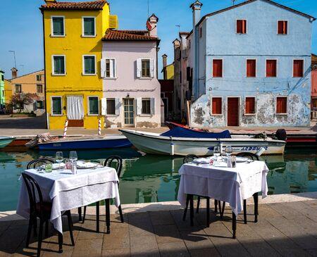 Covered tables on the island of Burano near Venice Standard-Bild