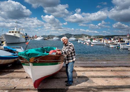 Fisherman repairs his boat