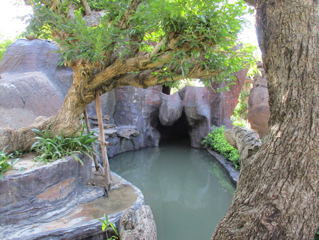Cave and green canal at Wat Tham Pha Daen in Sakon Nakhon, Thailand Stock Photo
