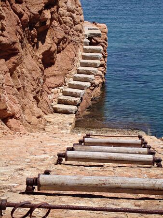 Mediteranean slipway for boats with old rollers Stock Photo