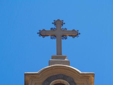 Stone cross with metal decoration Stock Photo