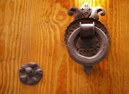 Old door hands shaped Knocker on an old wooden door Stock Photo - 918872