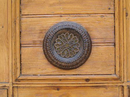 Door furniture on old wooden door in Girona Stock Photo