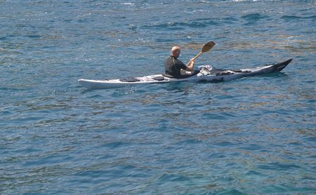 Sea Kayaker paddling on mediteranean sea
