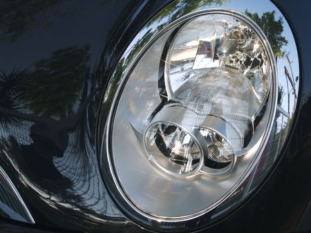 plastic, glass, metal and reflections auto headlight
