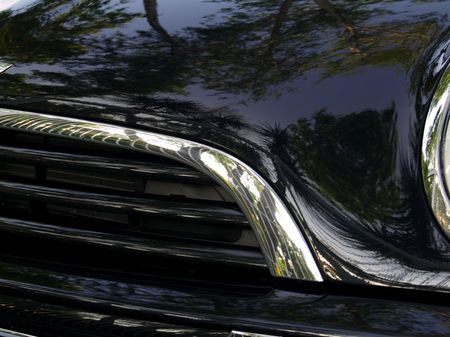 Black Car Headlight and grill with reflections