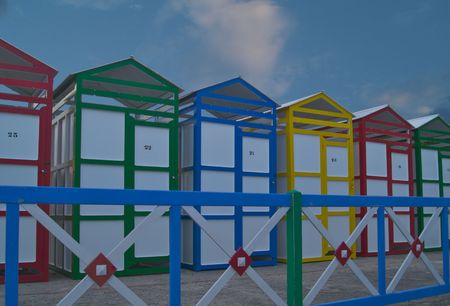 bathing huts St Pol with colourful  painted fence Stock Photo