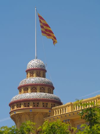 Tiled roof of the casino St Feliu with the Catalan Flag flying
