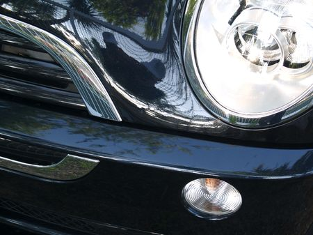 Black Car Headlight and grill with reflections Stock Photo - 1103879