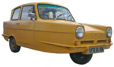 Old 3 wheel car made of fibreglass, much unloved Stock Photo